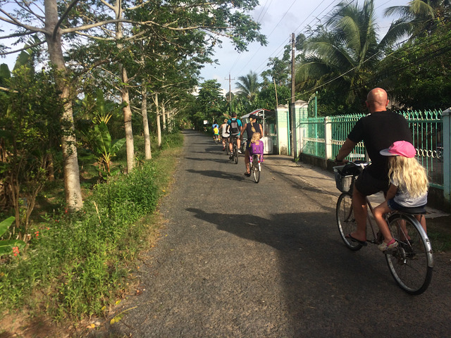 Mekong Delta Tour riding bicycle through the village