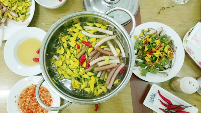 Siamese Fish hotpot with common sesban flower