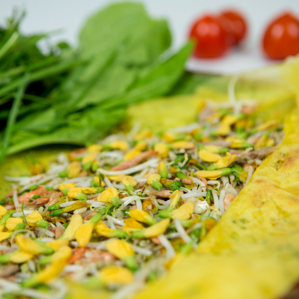 Vietnamese pancake with common sesban flower.